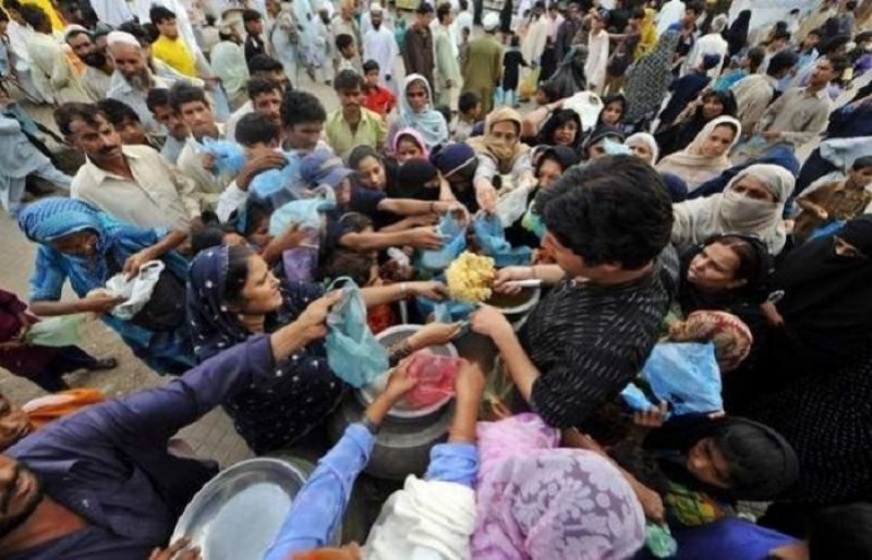 People getting food in a crisis situation in Pakistan