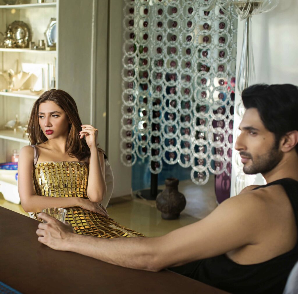 A candid photo of Mahira Khan sitting with Bilal Ashraf during the shooting of Superstar